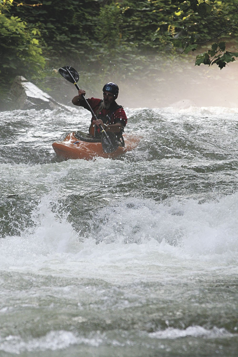 A boater approaches class III Nantahala Falls.
