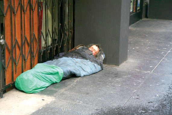 homeless in sleeping bag