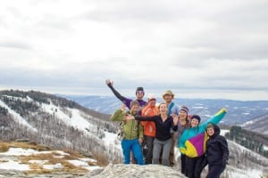 Chip Chase, Jess Daddio, and friends of BRO and White Grass enjoying the view from Weiss Knob